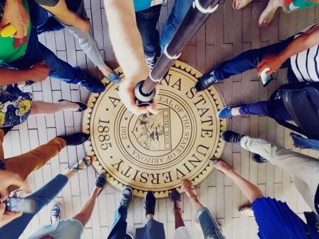 SUSI scholars' feet tapping the Arizona State University seal